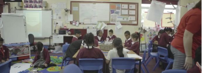 Image shows still image of a classroom from our condition-specific video for Hearing Impairment