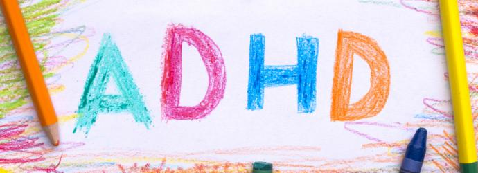 Colourful letters in crayon spelling out ADHD