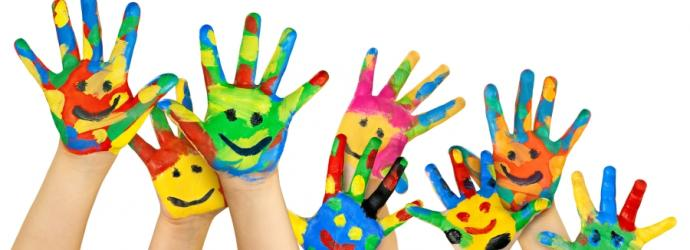 Children's hands painted with colourful faces