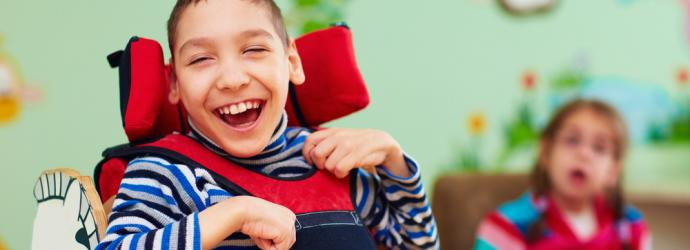 Young  boy in wheelchair with SEND in a classroom setting
