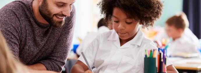 Teacher with primary student