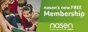 "Banner with a female teacher reading to a class of primary school pupils - banner says ""nasen's new FREE membership"""
