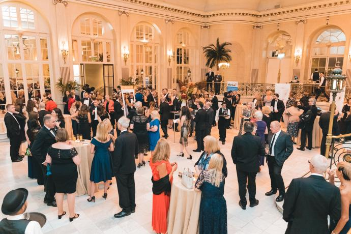Picture of guests at a drinks reception at the Waldorf Hilton Hotel for the nasen awards