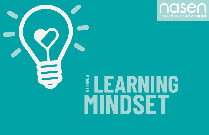 "A blue banner which has text on it saying "" We have a learning mindset"" features a lightbulb which has a heart in the middle of it on the left hand side and the nasen logo on the top right"